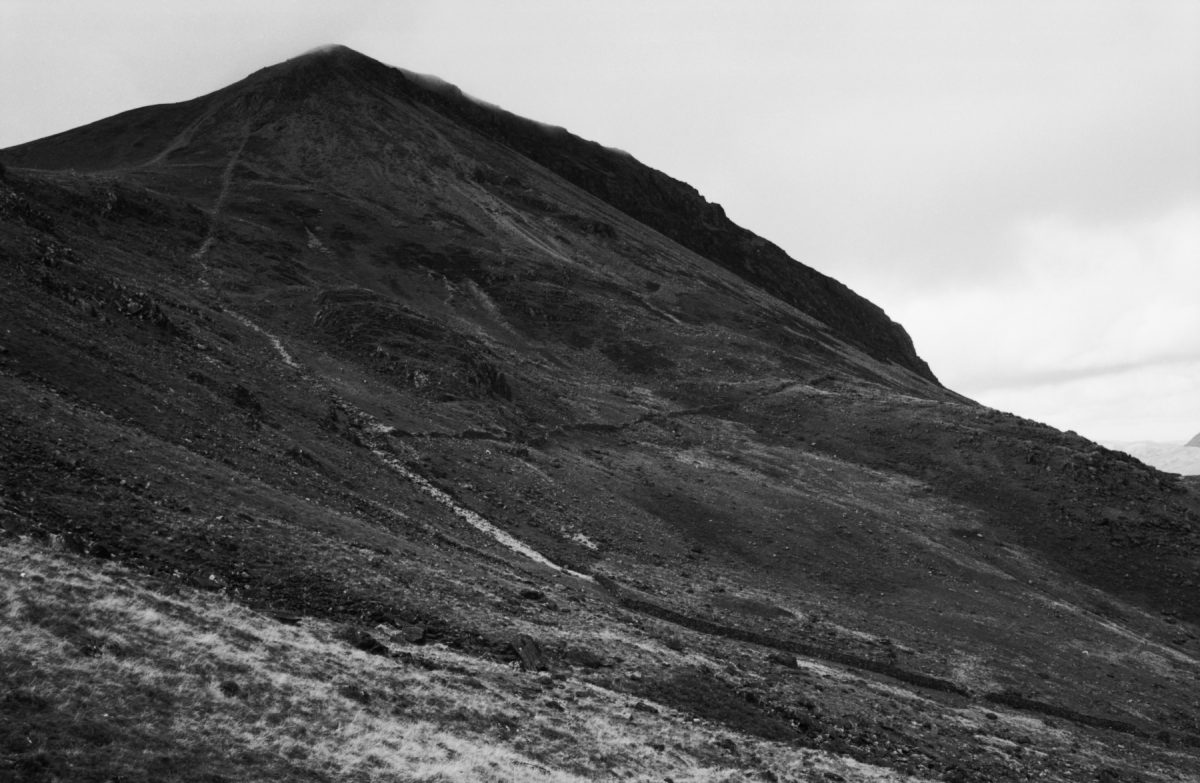 A monochromatic photograph of a mountain side
